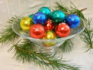 Holiday balls in dish white background (low)